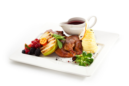 Duck Served with Fruits, Potato Mash and Sauce photo
