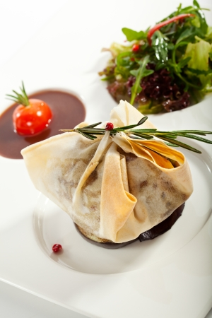 Beef Wellington Steak with Sauce and Vegetables photo