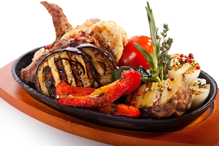 Grilled Meat Pan with Vegetables and Herbs photo