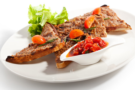 foodstuff: Toasted Bread with Meat Pate. Garnished with Tomato Sauce