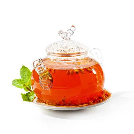 Sea buckthorns Tea with Fresh Mint Leaf photo