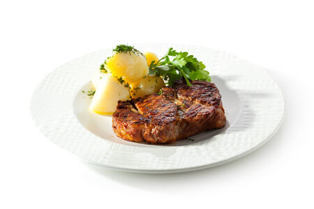 Pork Steak with Potato and Parsley photo