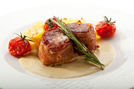 Bacon Wrapped Pork Medallions with Roasted Potato and Cream of Mushrooms Sauce