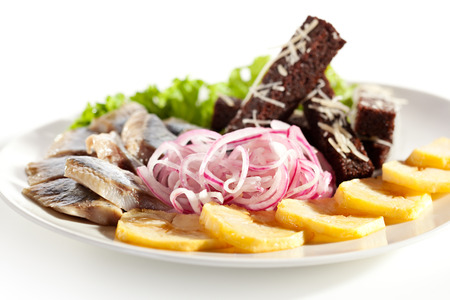 Herring Served with Potato, Onions and Bried Sticks photo