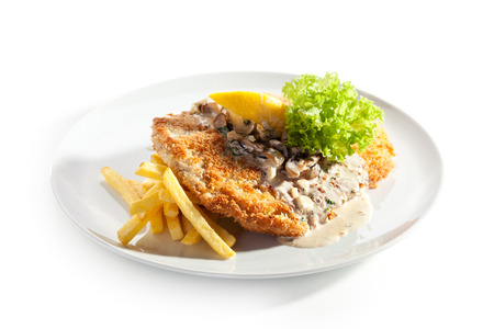 Vienna Schnitzel Served with Mushroom Sauce and French Fries photo