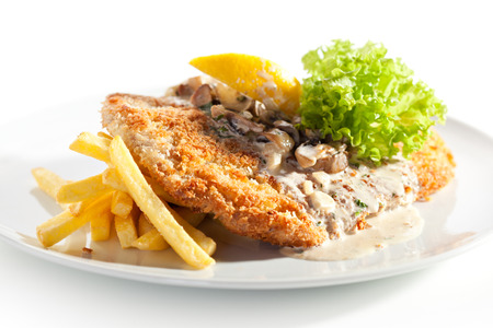 schnitzel: Vienna Schnitzel Served with Mushroom Sauce and French Fries