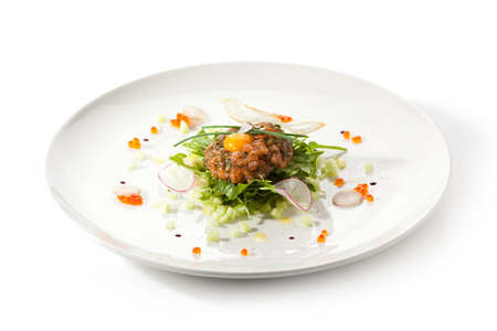 Salmon Tartare with Quail Egg and Rucola photo