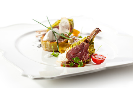 Roasted Lamb Chops with Pistachio. Garnished with Eggplant and Artichoke photo