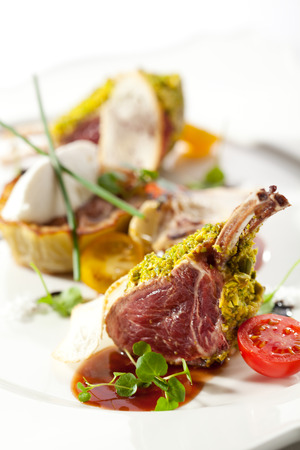 red braised: Roasted Lamb Chops with Pistachio. Garnished with Eggplant and Artichoke