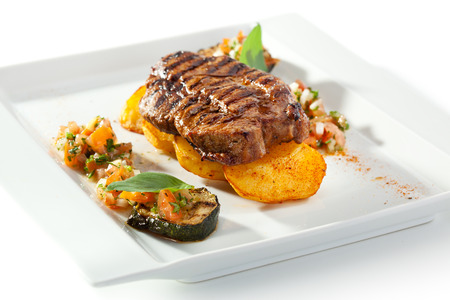 pork chop: Grilled Foods - BBQ Pork on Potato with Vegetables Stock Photo