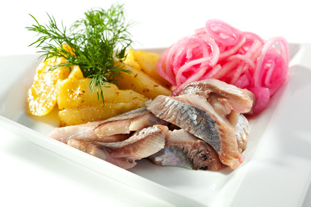 Salted Fish with  Boiled Potato and Pickled Onions photo