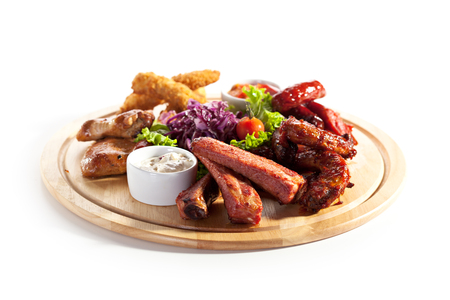Smoked Foods Plate - Chicken Sticks, Smoked Chicken Necks, Smoked Ribs, Smoked Chicken Wings and Salsa Sauce photo