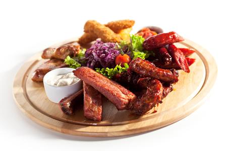 Smoked Foods Plate - Chicken Sticks, Smoked Chicken Necks, Smoked Ribs, Smoked Chicken Wings and Salsa Sauce photo