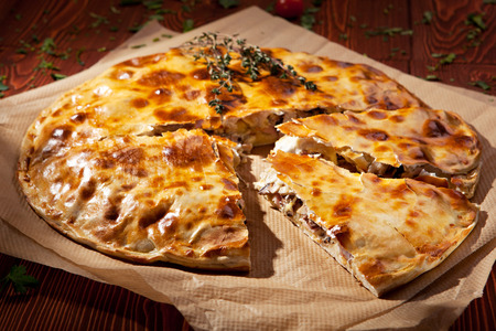 Sliced Pizza Calzone with Mushrooms and Ham photo