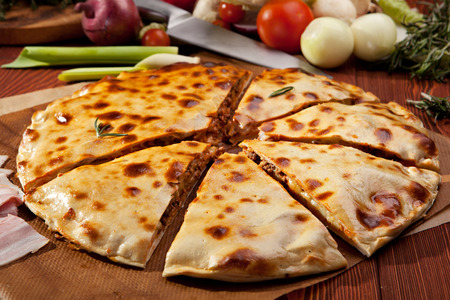 minced: Pizza Calzone with Minced Meat and Onions