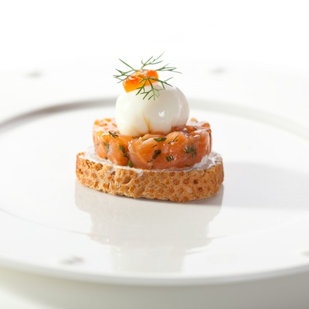 Salmon Tartare with Poached Quail Eggs and Caviar photo