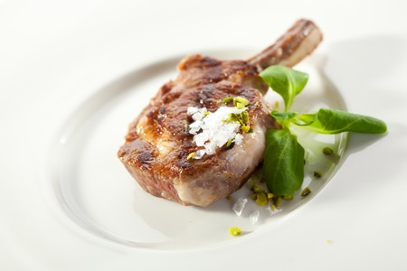Grilled Rack of Lamb Salt and Green Leaves photo