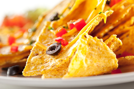 NACHO: Corn Chips with Cheddar Sauce Stock Photo