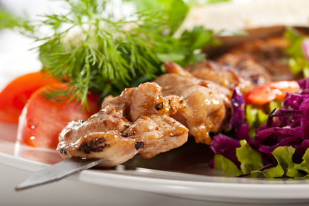 Grilled Chicken with Vegetables and Onions photo