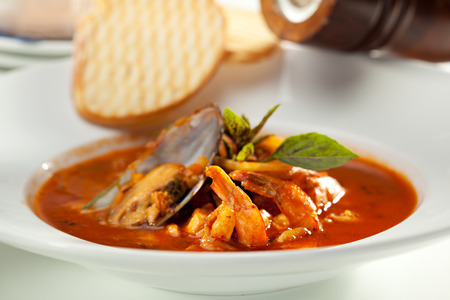 Seafood Soup with Bread and Basil photo