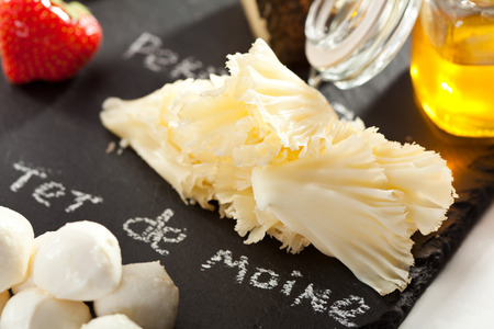 ange: Cheese Plate with Strawberries, Nuts and Honey Stock Photo