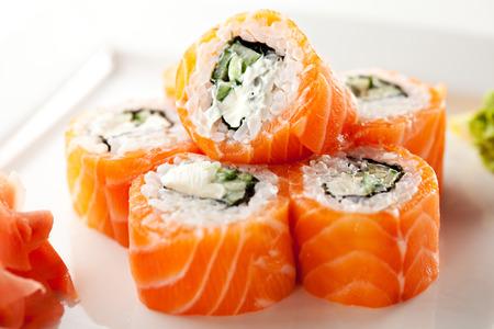 sushi plate: Philadelphia Maki Sushi made of Fresh Raw Salmon, Cream Cheese and Cucumber
