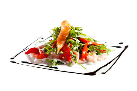 Salad with Sliced Salmon, Rucola and Paprika photo