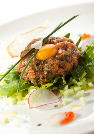 quail egg: Salmon Tartare with Quail Egg and Rucola
