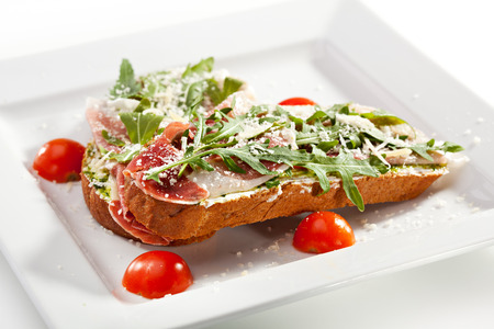 antipasti: Bruschetta with Parma Ham and Parmesan Cheese