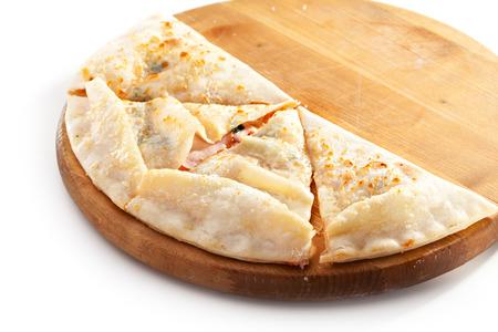 Calzone - Stuffed Pizza with Tomato, Mozzarella and Ham photo