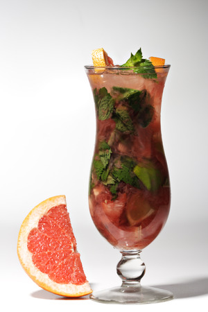 Grapefruit Cocktail with Lime, Sugar, Rum, Mint and Blackberry photo