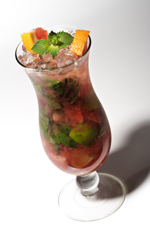 poured: Grapefruit Cocktail with Lime, Sugar, Rum, Mint and Blackberry Stock Photo