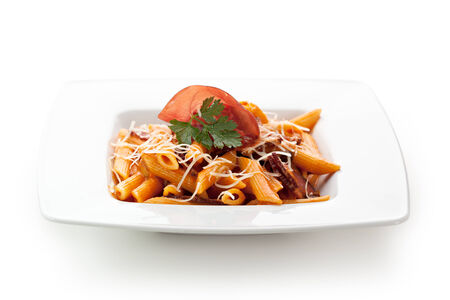 Pasta Penne with Bolognese Sauce  Garnished with Parsley, Sliced Meat and Parsley