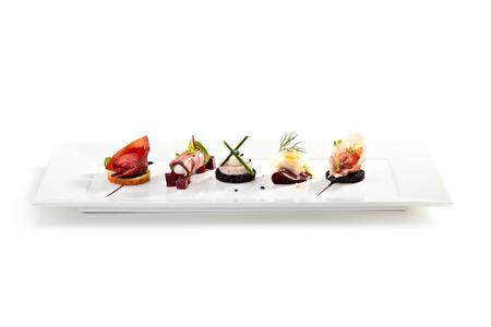 stravování: Maso Canapes bílé nádobí Reklamní fotografie