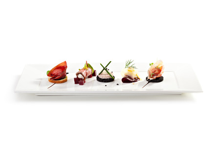 Meat Canapes on White Dish Stock Photo
