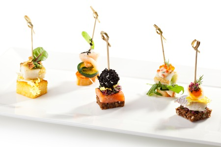 canapes: Seafood and Vegetables Canapes on White Dish