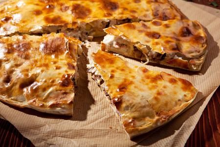 Pizza Calzone with Mushrooms and Ham photo