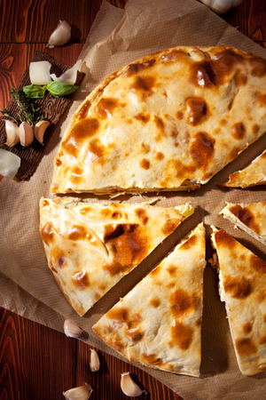 Piece of Pizza Calzone with Chicken photo