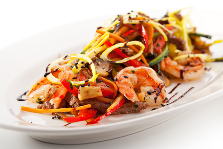 Thai Cuisine - Beef fried with Vegetables and Tiger Shrimps photo