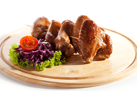 Hot Meat Dishes - Smoked Chicken Wings with Salad Leaves photo