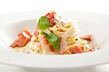 carbonara: Traditional Carbonara Spaghetti with Meat and Cheese Stock Photo