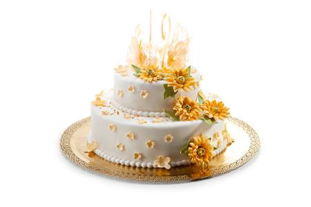 pastel de bodas: Delicioso Aderezo Torta de boda con las flores Foto de archivo