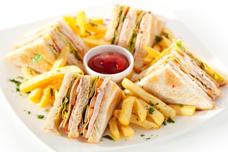 ham sandwich: Club Sandwich with Cheese, PIckled Cucmber, Tomato and Smoked Meat. Garnished with French Fries