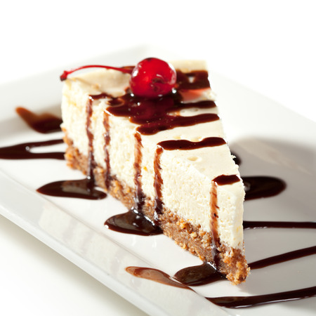 Cheesecake with Chocolate Sauce and Cherries photo