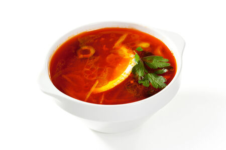 solyanka: Soup - Solyanka. Dish of Stewed Cabbage and Meat with Spices and Lemon Stock Photo