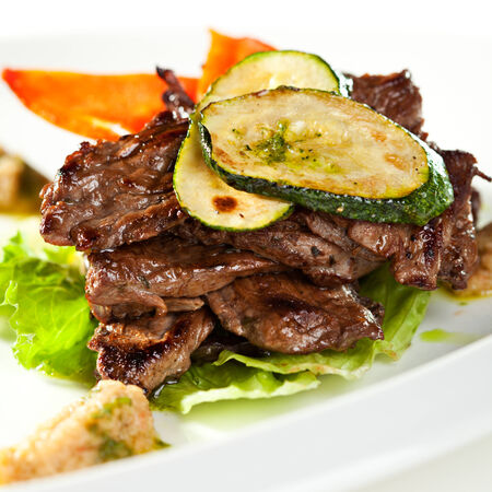 beef cuts: Fried Prime Beef on Salad Leaf Topped with Zucchini