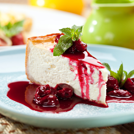 small cake: Dessert - Cheesecake with Berries Sauce and Green Mint