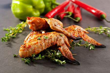 Grilled Chicken Wings with Thyme and Hot Chili Pepper photo