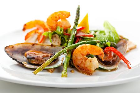 seafood salad: Fried Seafood Salad with Lemon Slice and Asparagus Stock Photo