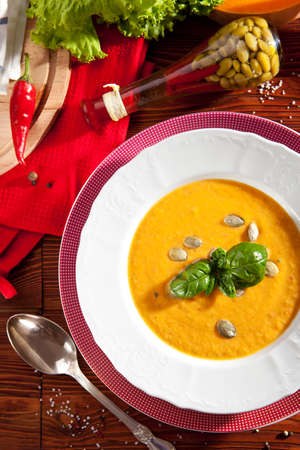 Bowl of Pumpkin Soup with Fresh Basil photo